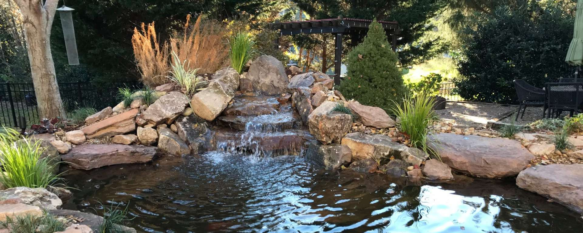 rocky waterfall feature with natural pond